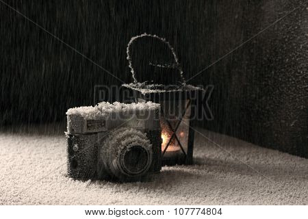 Old camera in the snowing