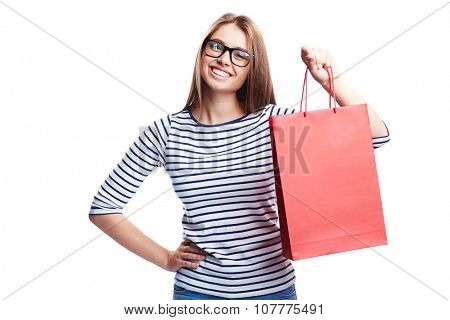 Happy girl in casualwear and eyeglasses looking at camera after shopping
