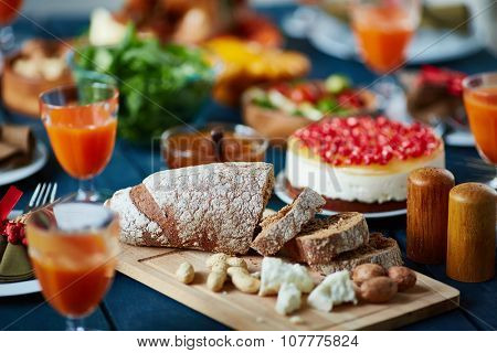 Slices of rye bread and other food on festive table
