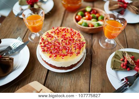 Appetizing Thanksgiving dessert with pomegranate seeds on festive table