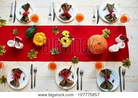 Festive table served and decorated for holiday dinner