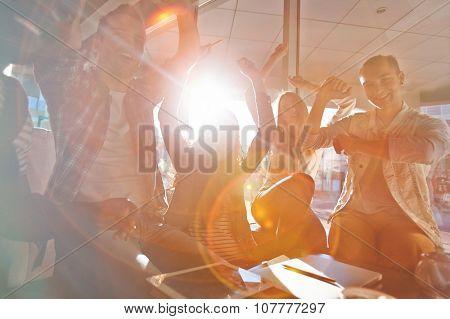 Ecstatic teens enjoying nice day in cafe