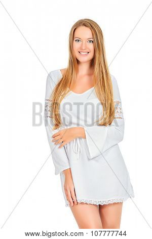 Attractive young woman in a white summer dress. Isolated over white.