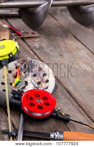 Closeup Ice Fishing Tackles And Equipment