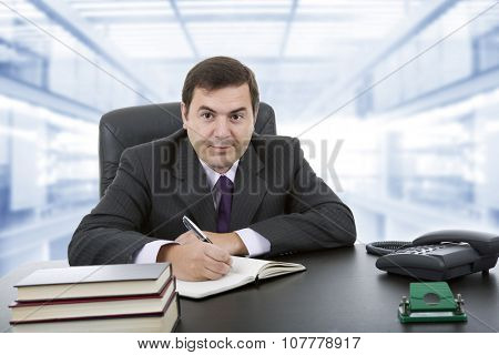 young businessman writing on a desk, at the office