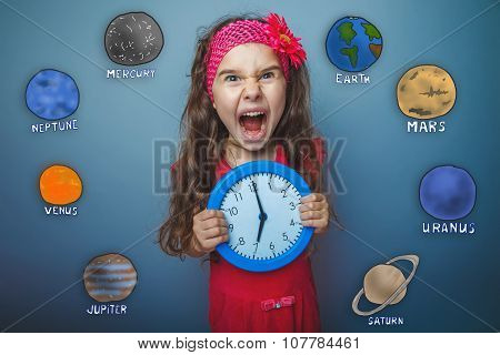 Teen girl gets angry and yells holding round the clock in the ha