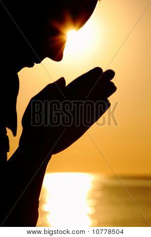 Silhouette Of Woman Which Sits Near  Sea Opposite  Sun