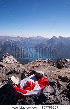 Canadian flag on a mountain