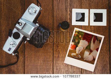 Instant photo against view of an old camera with photos slides