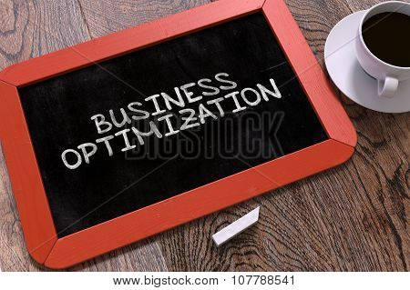 Business Optimization Handwritten by White Chalk on a Blackboard
