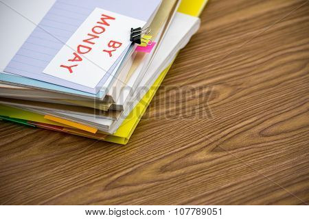 By Monday; The Pile Of Business Documents On The Desk