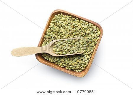 green coffee beans in wooden bowl on white background