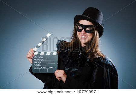 Woman wearing mask with movie board