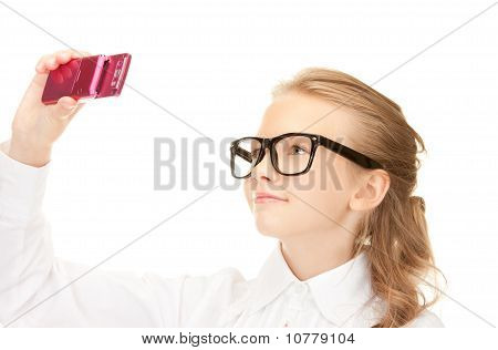 Happy Girl Taking Picture With Cell Phone