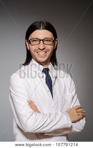 Young physician against gray