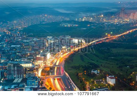 Panorama of Night road with motion traffic in residential district, city life, Istanbul, Turkey