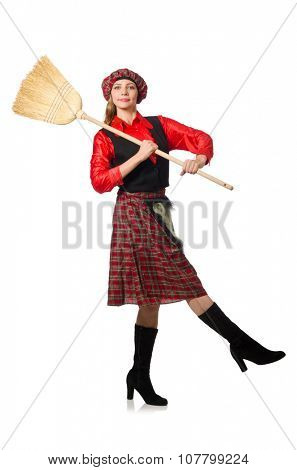 Funny woman in scottish clothing with broom