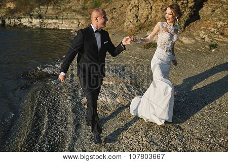 photoshoot lovers in a wedding dress in the mountains near the s