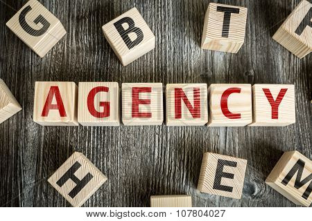 Wooden Blocks with the text: Agency