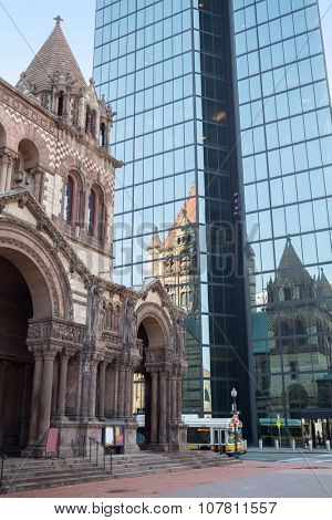 USA, BOSTON -  05 SEP, 2014: Trinity Church in Copley Square is reflecting on John Hancock Tower.