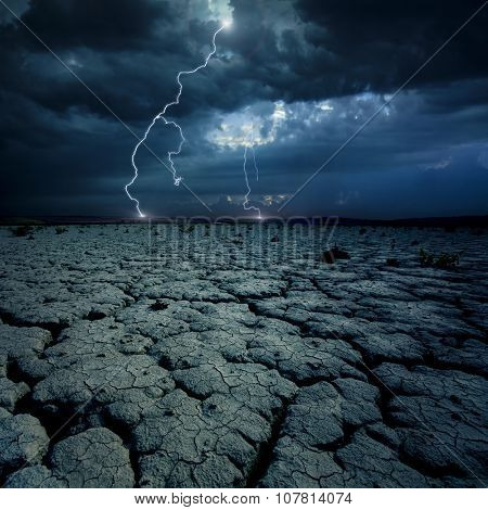 Cracked land and distant lightning