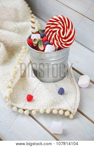 Colorful Candies In A Small Bucket
