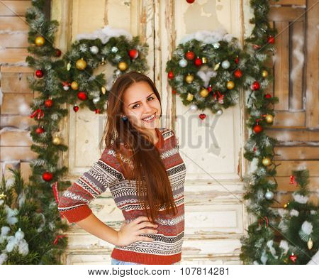 Happy Teen Girl By The Christmas Decorations