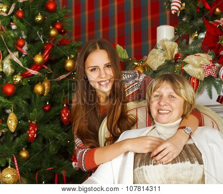 Grandmother And Teen Granddaughter Near The Christmas Tree