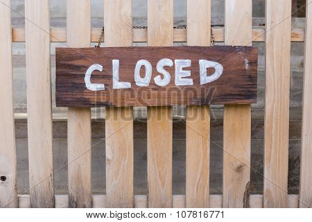 Wooden Close Signboard Hanging On Small Wood Fence