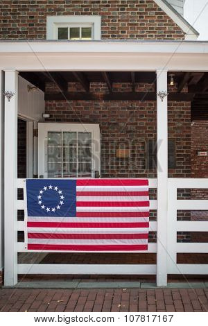 USA, PHILADELPHIA - SEP 02, 2014: American flag is hanging on the fence at the Betsy Ross House.