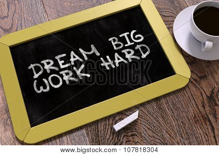 Dream Big, Work Hard. Inspirational Quote on Chalkboard.