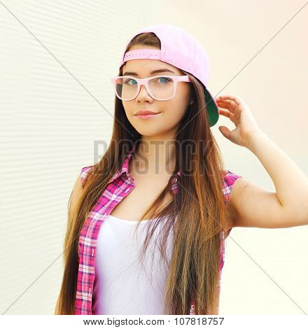 Pretty Cool Girl Wearing A Pink Baseball Cap And Glasses