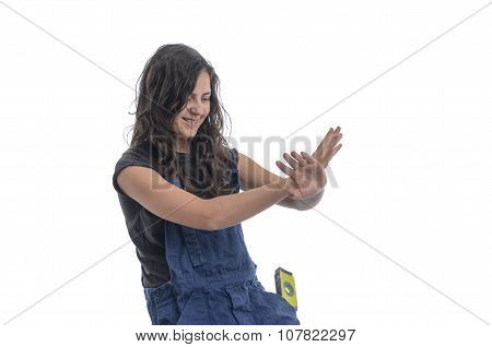 Worker woman with blue overalls.