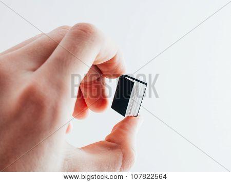 Super small book in hand