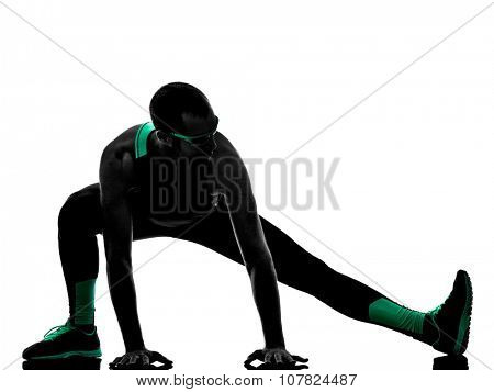one man exercising fitness  stretching warming up   in silhouette isolated on white background