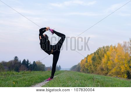 Beautiful Ballerina Dancing Outdoor On Sunny Autumn Day