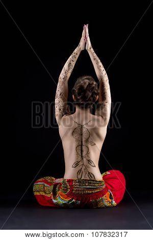 Yoga and mehndi. Image of topless woman meditating