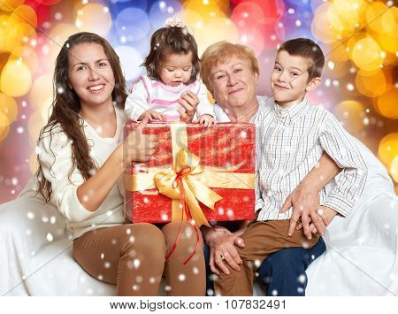happy family with box gift - holiday concept on colorful background and snow