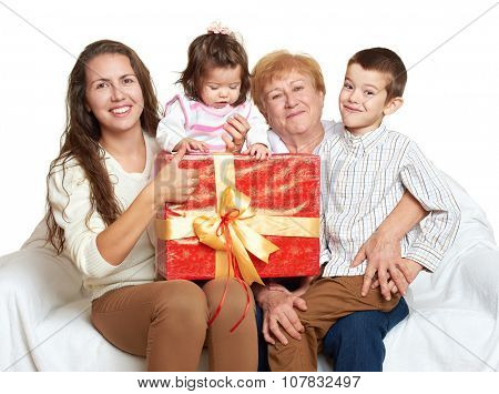happy family with box gift, woman with child and grandmother - holiday concept