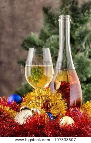 Christmas still life with champagne and decorations