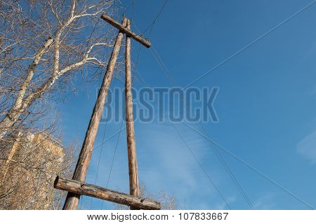 Wooden poles (support) power transmission lines.