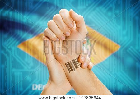 Barcode Id Number On Wrist And Usa States Flags On Background - Delaware