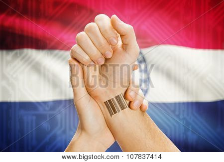 Barcode Id Number On Wrist And Usa States Flags On Background - Missouri