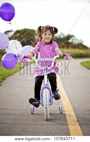 Girl Riding A Bycicle