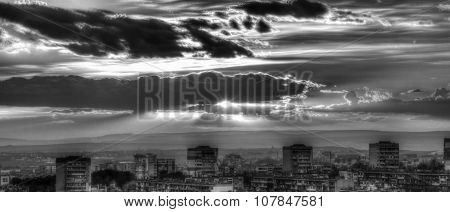 Sunset over city in black and white