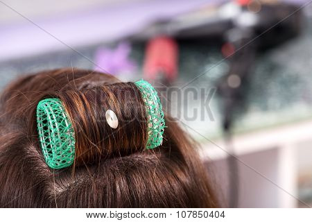Single Large Green Roller In Brown Hair