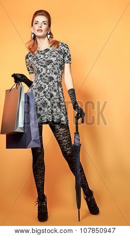 Fashion beauty woman holding shopping bags.Vintage