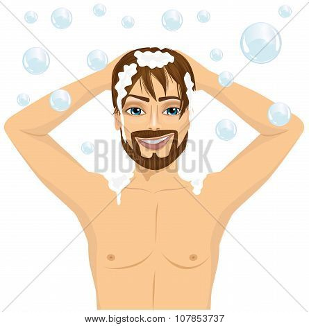 handsome man washing hair with shampoo