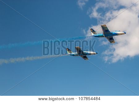 UKRAINE, KHARKIV -AUGUST 24: airplanes in the sky with colorful smoke of ukrainian flag on Ukraine Independence Day  in Kharkiv on August 24, 2015