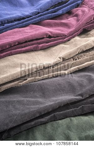 Closeup of Assorted Colors of Velvet Pants